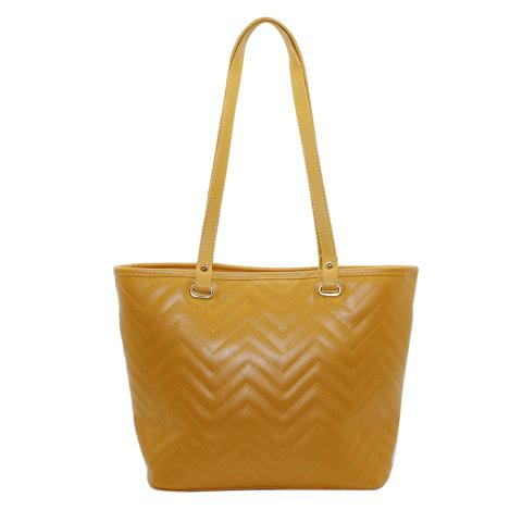 The yellow quilted tote bags with zigzag stitching details.this large shopper bag have front large snap pocket, top zip pocket and inside two slip pocket to carry more things inside.