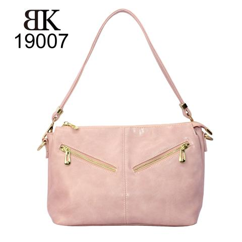 The cute pink hobo bags feature reversed double zippers on the front, adjustable strap, top zip closure and  light gold hardware.