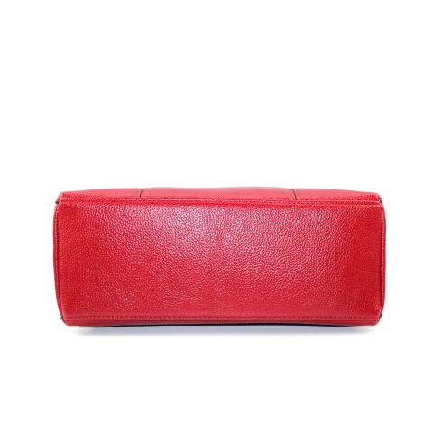Crafted from pebble materials in a red and features unregular flap with magnetic closure and adjustable strap.