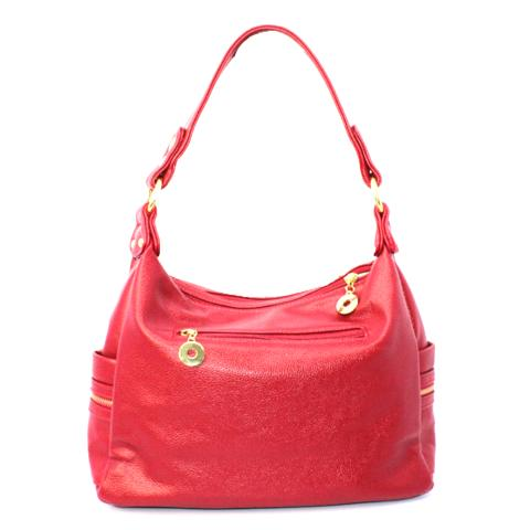 Crafted from pebble leather materials in a red and features polished light gold hardware, multipockets and adjustable strap.