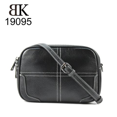 Portable black shoulder bag with clear thread