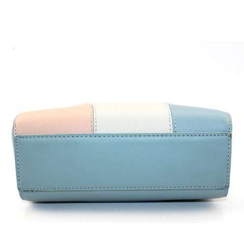 The colorful purse features silver hardware, adjustable strap and top zip closure to keep things secure.