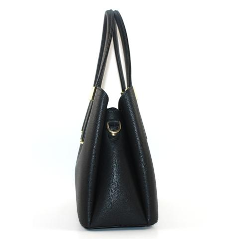 The casual black tote bag features top handles, detachable strap, light gold hardware and top magnetic closure.