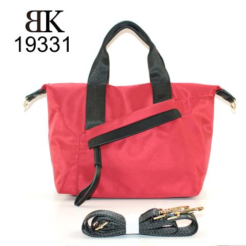 Look nylon material is adorned with gold hardware, the color goes with black and red, an exterior distinctive zipped pocket detail on front, what a simple and stylish bag!