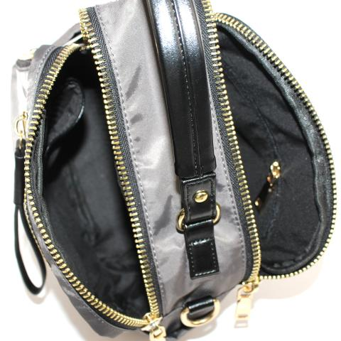 Creating stylish pieces that transcend seasonal trends as seen on this belt bag featuring a front zip pocket, a top zip closure, an adjustable fastening and gold-tone hardware