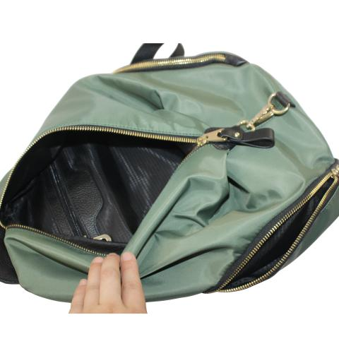 Featuring zipper pocket on front, two little zipper pocket on side, golden hardware and has a bog with ample room to carry all of your necessities.