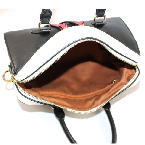 The fashion handbag's color goes with black, white and red, with ample room to carry all of your necessities, gold tone hardware, top zip to keep things secure.