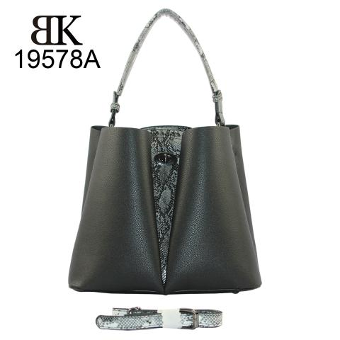 The stylish black handbag, featuring single handle, lock closure and distinctive design detail on front. And detachable adjustable shoulder strap.