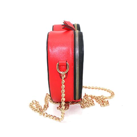 The red heart shoulder bag combines uptown elegance with downtown ease. It's crafted in a smooth leather.and finished with top zipper closure,light gold hardware.Convert the chain strap.inside with a zip pocket.