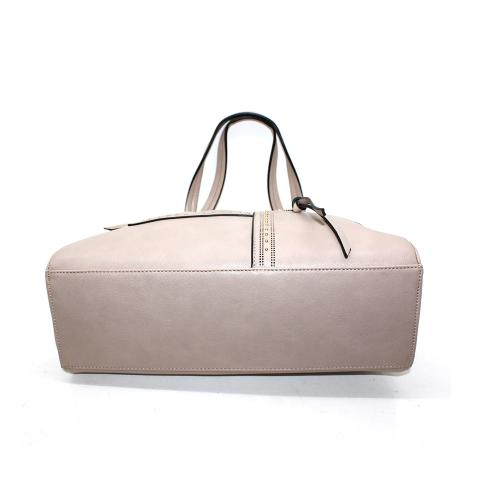 Handcrafted from PU leather, this tote bag is updated with multiple pocket compartments in a beige color finish, tuck important items-such as your keys, phone and wallet-in the side zippered compartments.