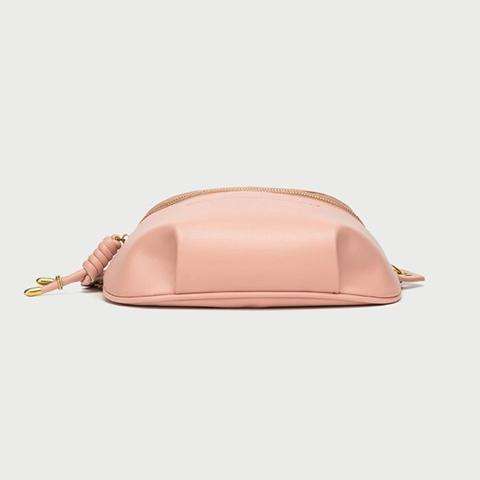 Channeling the season's effortless, downtown-inspired looks, this belt bag is crafted from pink plain leather. Front zip pockets offer just enough room to store your phone, lip gloss and keys. Wear it around your waist, or sling it over the shoulder depending on your mood.