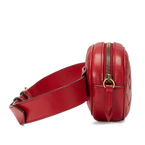The red waist bag features clear stitching, adjustable strap, light gold hardware and top zip pocket.